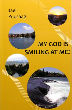 Jael Puusaag's book called My God is smiling at me! cover.